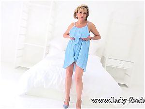 british mature gal Sonia plays with her hard nips