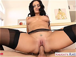 brown-haired mother in tights Ava Addams railing pink cigar