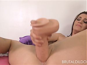 Cici Rhodes punishes her rosy poon with brutal fake penises