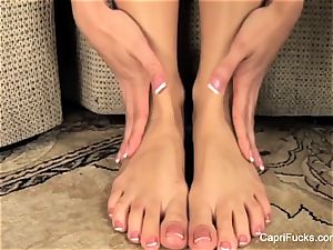 gorgeous Capri Cavanni plays with her cute soles